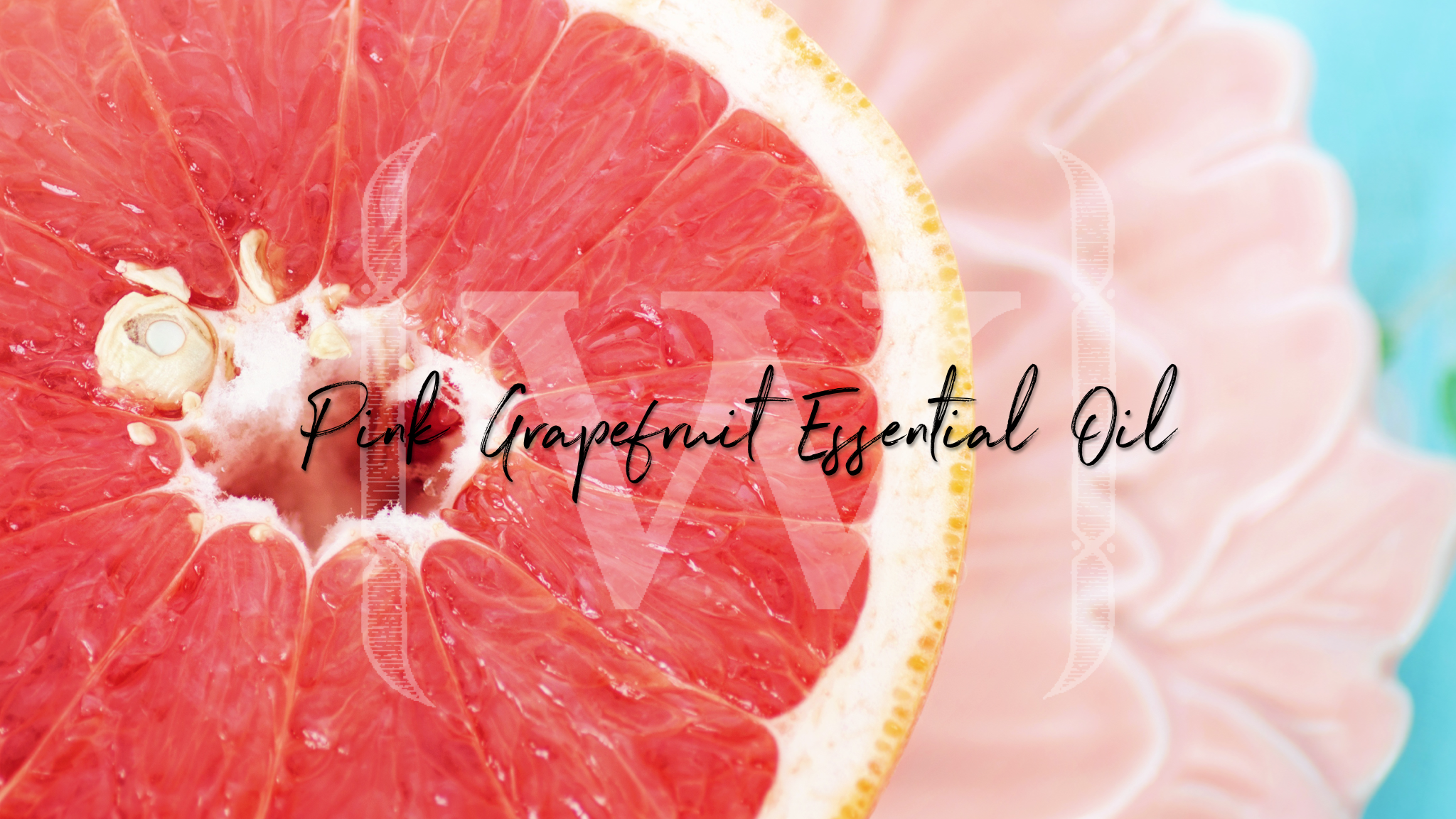 "Pink grapefruit with text over the top that reads ""Pink grapefruit essential oil""."